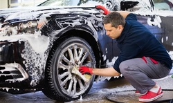 First Month of Unlimited Deluxe, Super, Ultimate, or Tire Shine Washes at Splash Car Wash (Up to 56% Off)