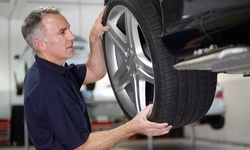 $49 for Four-Wheel Alignment, driving test, and balance check at J & M Discount Tire & Auto ($99 Value)