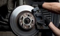 Brake Pad & Optional Rotor Replacement at Starbrite Express Lube & Automotive Repair (Up to 16% Off). 2 Options.
