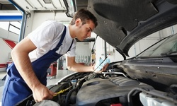 Oil-Change Package or State Safety Inspection and Emissions Test at One King Automotive (Up to 70% Off)