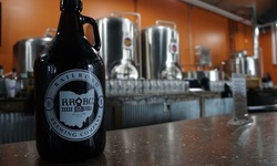 Pint with Four-Pack of 16oz Cans and Growler for One or Two at Railroad Brewing Company (Up to 27% Off)