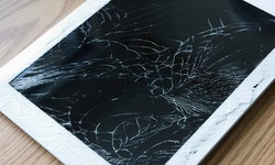 Glass Repair for an iPhone  or $20 for $40 Worth of Phone or Computer Repair at Cell Phones and More