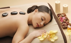 One-Hour Masssage w/ CBD Balm & Hot Towels or Hot Stones at Elevate Massage and Sports Recovery (Up to 34% Off)