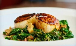 Upscale Pub Food Sunday–Thursday or Friday–Saturday at The RowHouse Grille (50% Off)