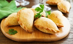 $7 for $10 Toward Food and Drink for Takeout and Dine-In if Available at The Empanada CookHouse