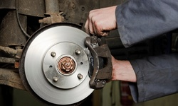 Front or Rear, or Both Break-Pad Replacement at RPM Auto Care Center (Up to 50% Off). Two Options Available.