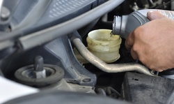 Up to 16% Off on Car & Automotive Brake Fluid Flush at Driveworks Tire And Auto Center