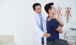 One or Two Spinal Evaluations with Adjustment and Chair Massage at Hoffman Chiropractic (Up to 85% Off)