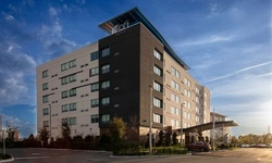 Stay with parking and breakfast at Aloft Hotel by Marriott Orlando Lake Buena Vista in Orlando, FL