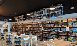 Unlimited Game Play for One, Two, or Four with $10 Food Credit at Your Turn – A Board Game Cafe (Up to 36% Off)