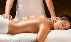 One, Two, or Three 45-Minute Detoxifying Copper Hot-Stone Massages at Wholly Holistics (Up to 40% Off)