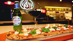 $10 For $20 Worth of Pizza, Salad & Pasta (Also Valid On Take-Out W/Min. Purchase $30)
