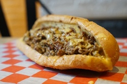 Up to 30% Off on American Cuisine at Izzies Cheesesteaks