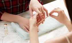 GelManicure or Classic Manicure and Pedicure at Eri's Nails & Beauty (Up to 56% Off)
