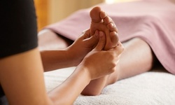 One 45- or 30-Minute Delux Reflexology Package at Warm Reflexology & Massage (Up to 54% Off).
